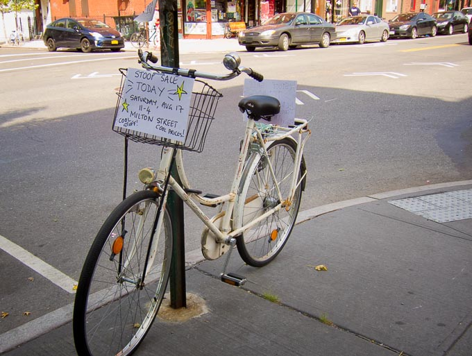 Photo of 'stoop sale' sign on bicycle